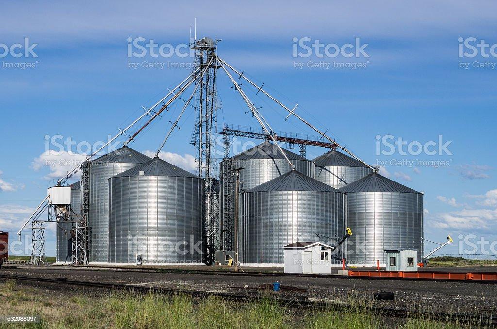 Metal grain storage silo facility stock photo