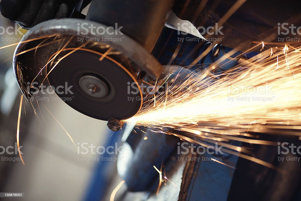A metal grinder grinding some metal stock photo