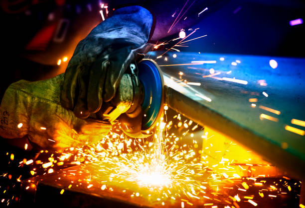 Metal grinding technology stock photo CNC Machine, Metal, Foundry, Industry, Grinding Electric wheel CNC grinding on steel structure produces colorful sparks metal industry stock pictures, royalty-free photos & images