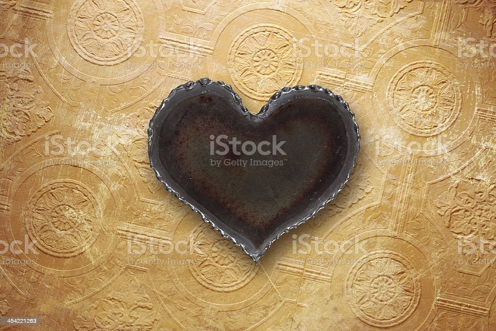 Metal Heart On Old Wallpaper Stock Photo - Download Image