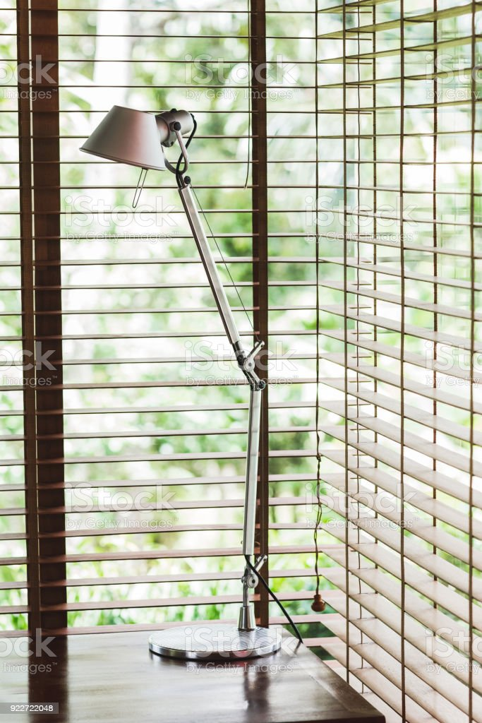 Metal High Desk Lamp In Office, Blinds On Windows, Minimalist Style  Royalty Free