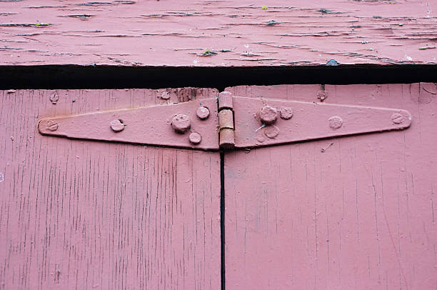 pink mauve hinges crudely fixed - whiteway stock photos and pictures