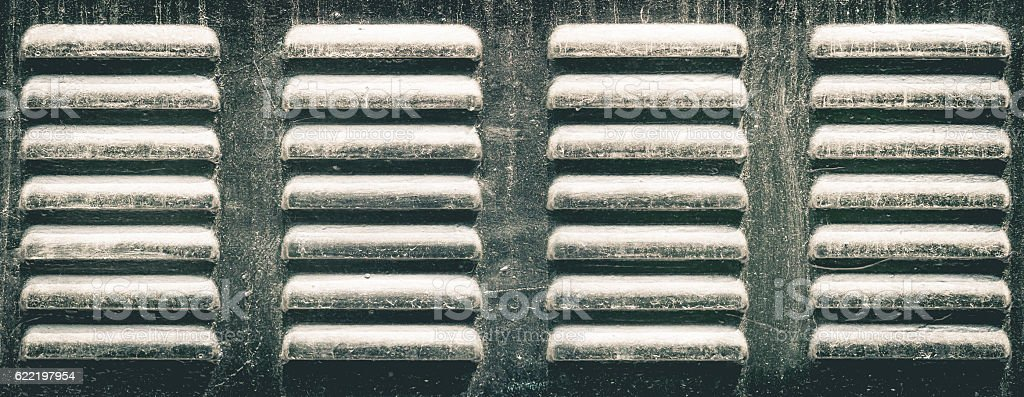 metal holes of ventilator air passage of a refrigerator stock photo
