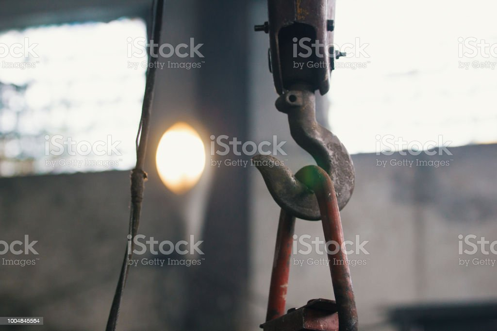 Metal hook for lifting cargo on the manufacture, telephoto shot