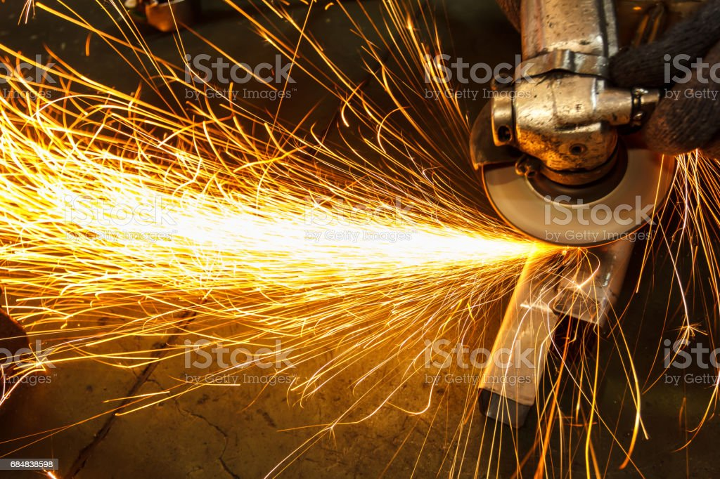 Metal in a factory grinding with sparks stock photo