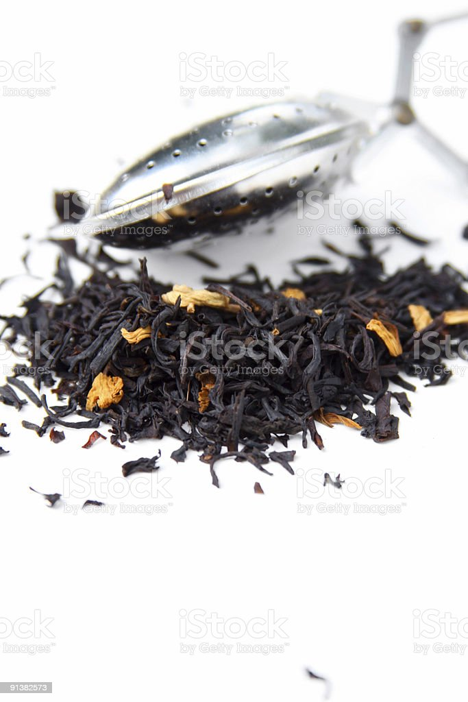 Metal infuser and black Tea leaves royalty-free stock photo