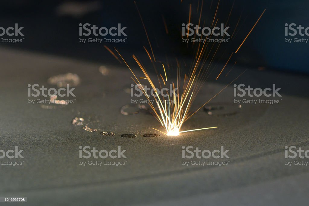 Metal is sintered under the action of laser into desired shape stock photo