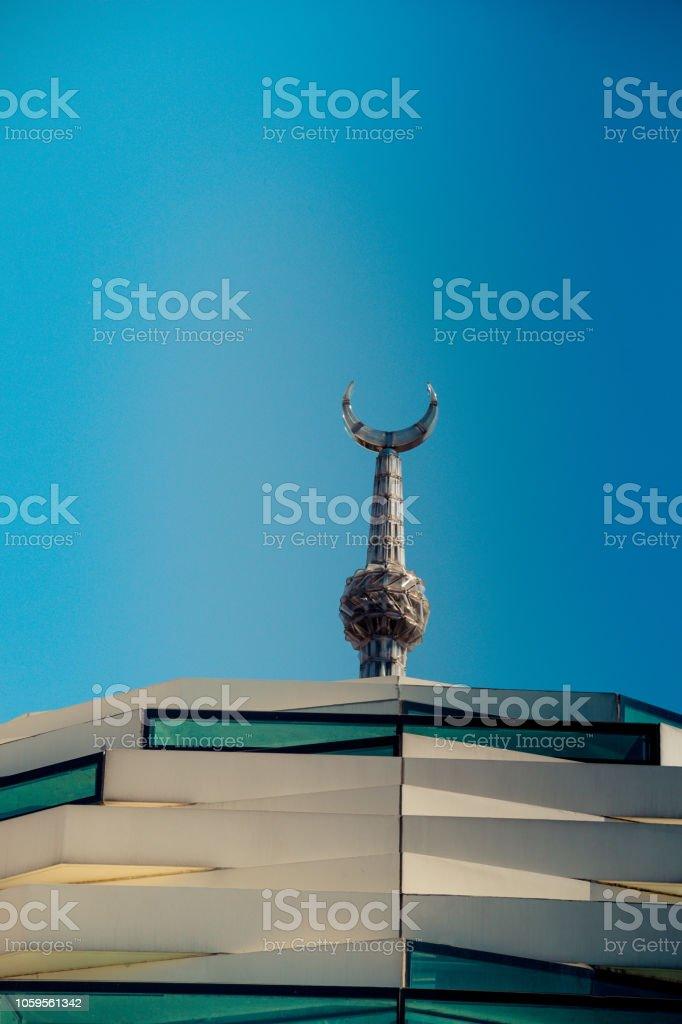 Metal islamic crescent moon icon stock photo