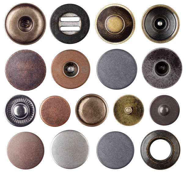 Metal jeans buttons and rivets set collection on white background. stock photo