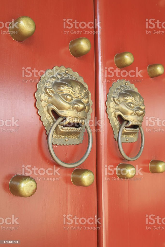 metal Knocker on door in the Forbidden City royalty-free stock photo
