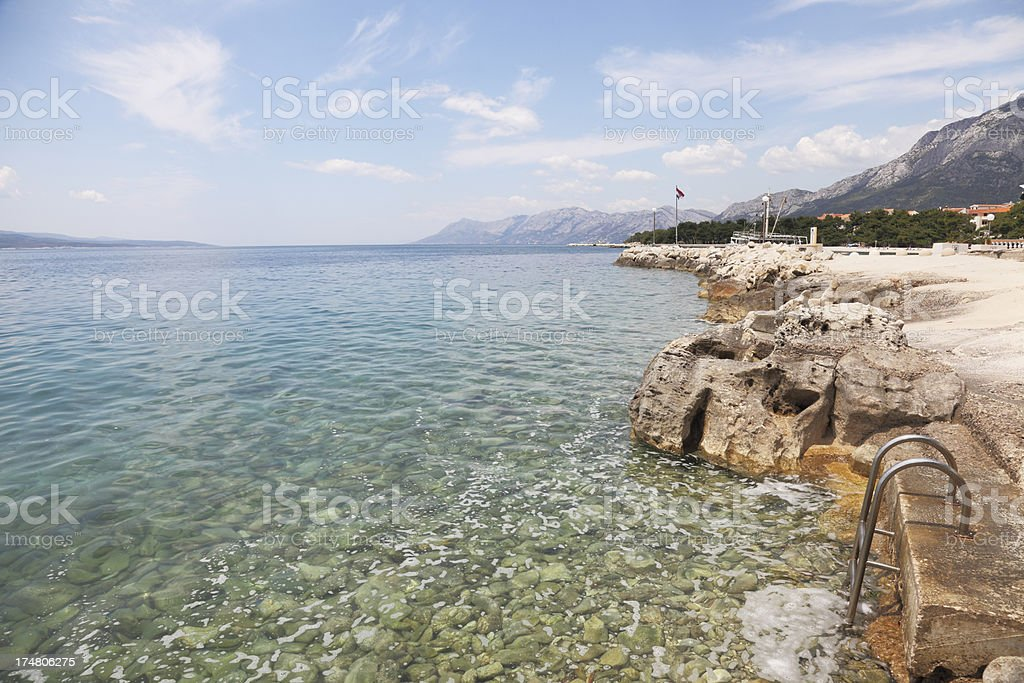 metal ladder into turquoise blue mediterranean beach Croatia royalty-free stock photo