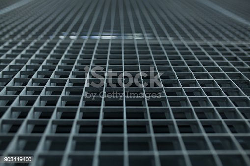 istock Metal lattice with small cells grid stock background with shallow dof and selective focus 903449400