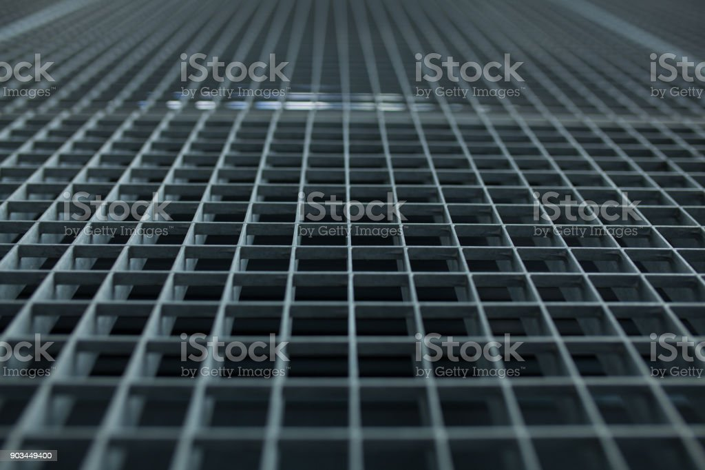Metal lattice with small cells grid stock background with shallow dof and selective focus stock photo