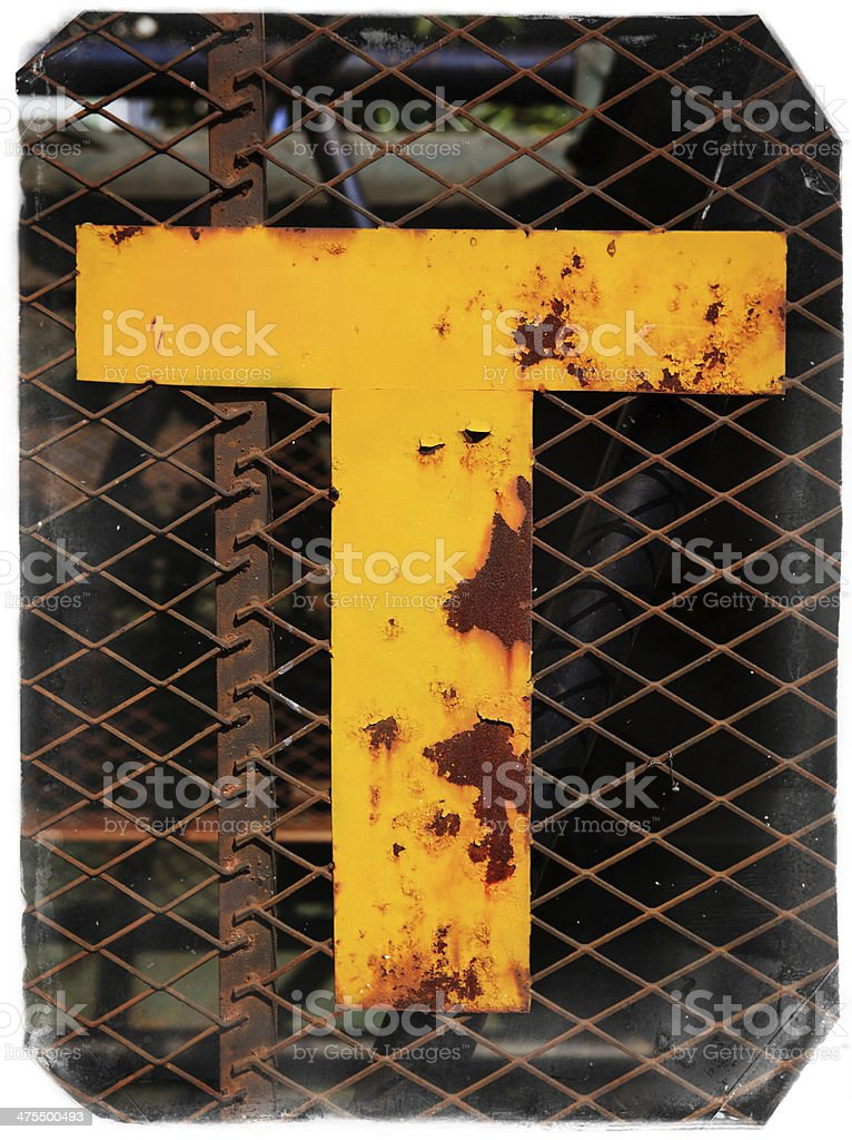 Metal letter T stock photo