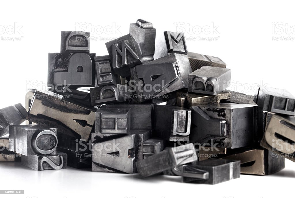 Metal letters bunched up in a pile stock photo