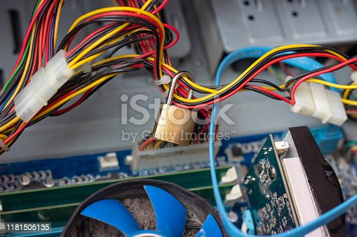 873468774 istock photo Metal lock on computer wires as data protection and cyber safety concept. 1181505135