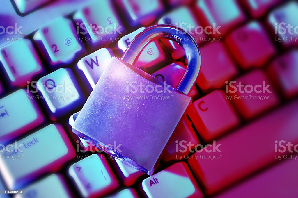 Metal lock placed on a keyboard royalty-free stock photo