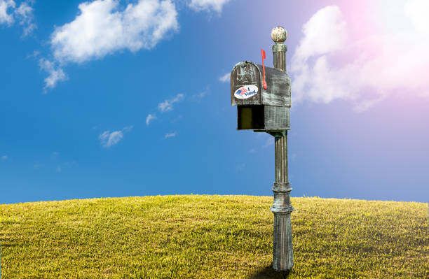 USPS metal mailboxes for rural homes with I voted sticker for vote by mail stock photo