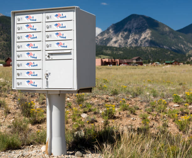USPS metal mailboxes for rural homes with I voted stickers for vote by mail stock photo