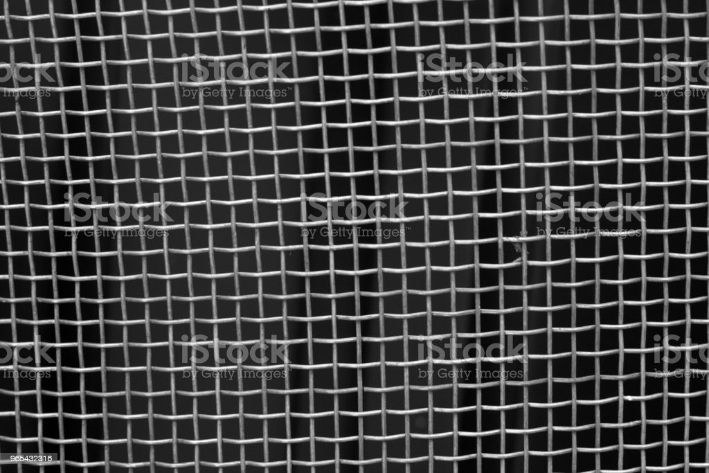 Metal mesh grid pattern in black and white. royalty-free stock photo