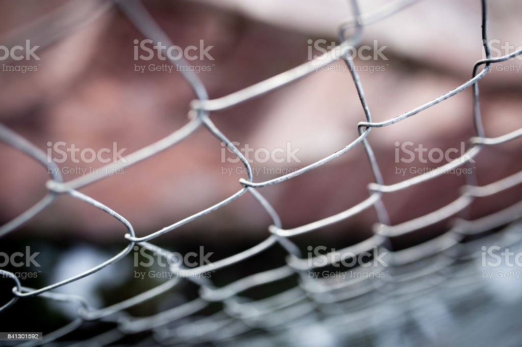 Metal mesh on the fence as a background stock photo