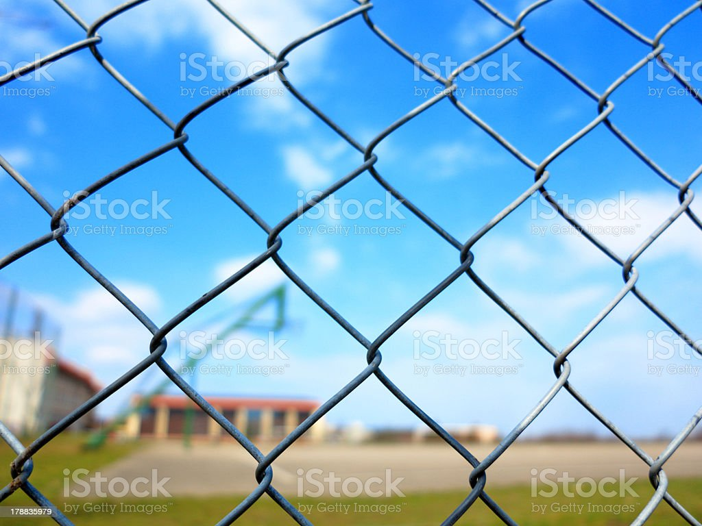 Metal mesh with blur basketball court background royalty-free stock photo