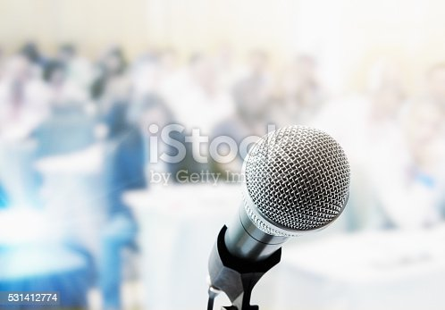 istock Metal microphone with out-of-focus people in background 531412774
