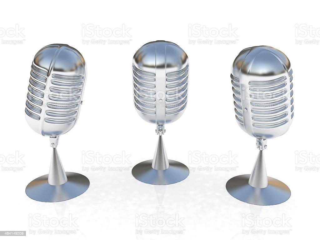 3 metal microphones stock photo