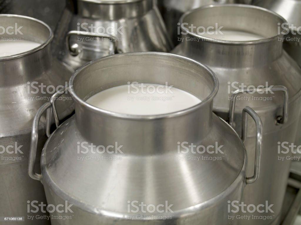 metal milk jugs stock photo