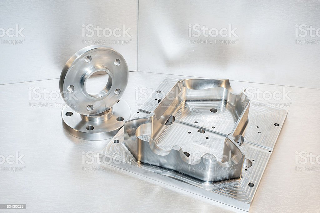Metal mold and steel flanges. Milling industry. CNC technology. stock photo