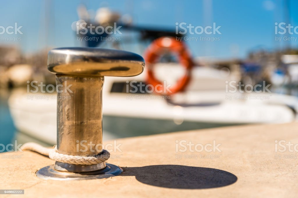 metal mooring for recreational boats in marina stock photo