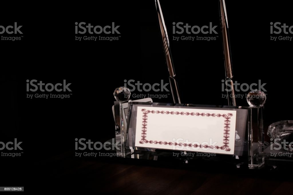 Metal name plate on a desk. stock photo