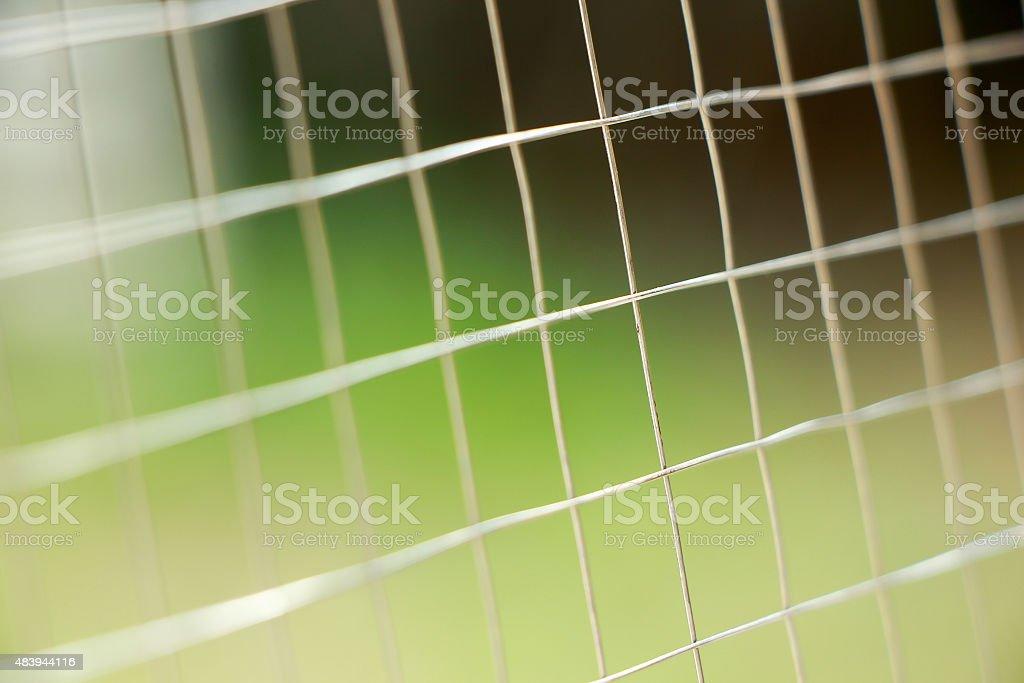 Metal net fence background stock photo