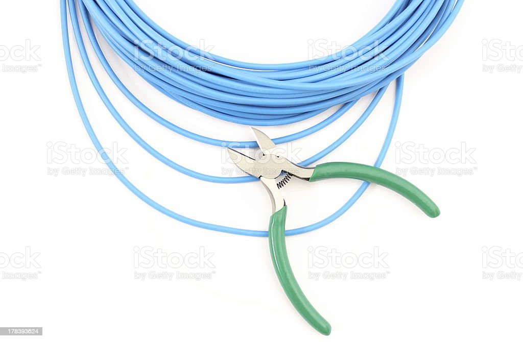 Metal nippers and blue cable on white background royalty-free stock photo