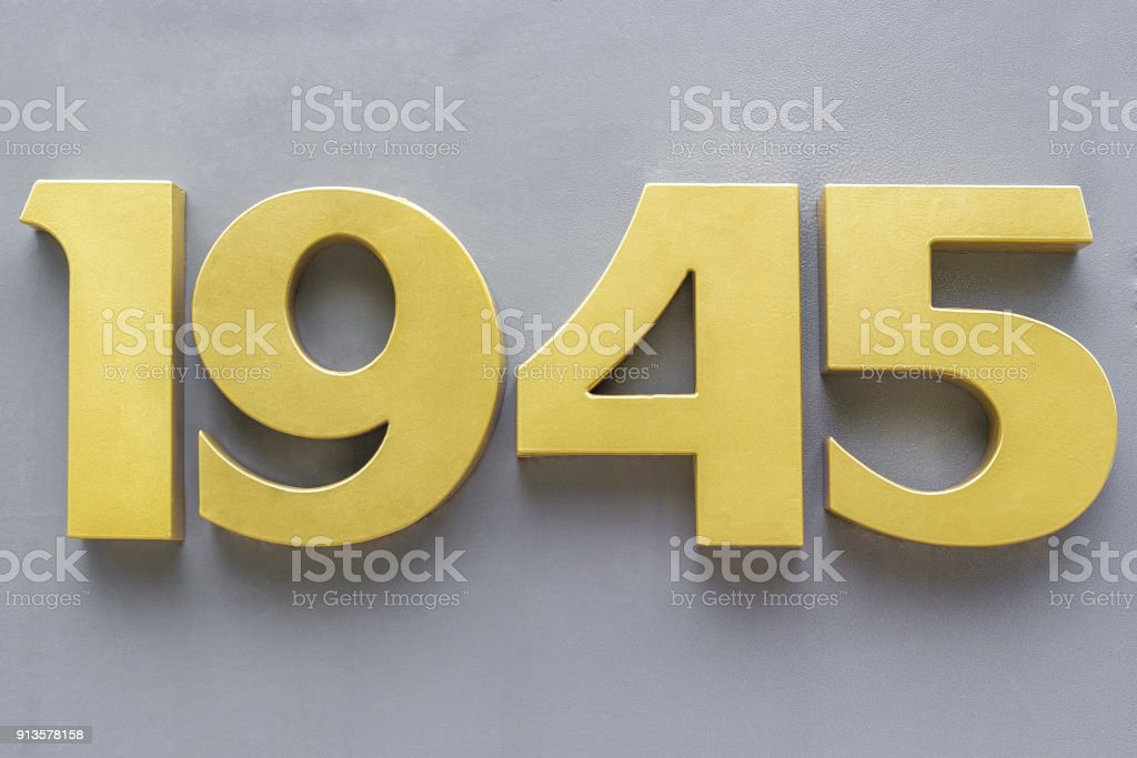 metal numbers  on a gray background stock photo