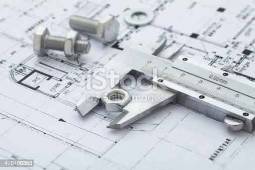 istock Metal nut measuring Vernier calipers on drawing 476456353