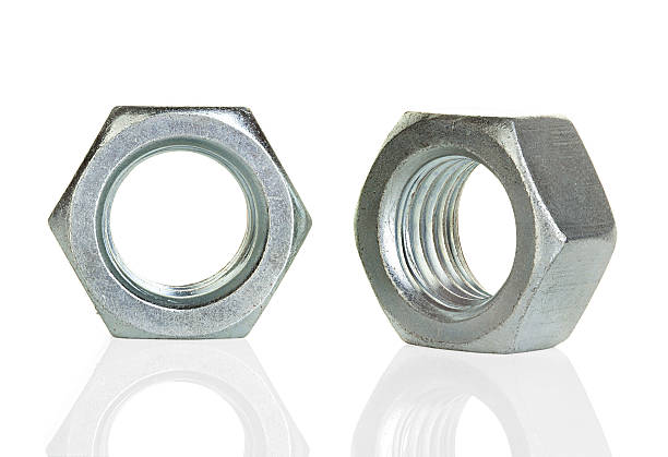 Metal nuts isolated on white background stock photo