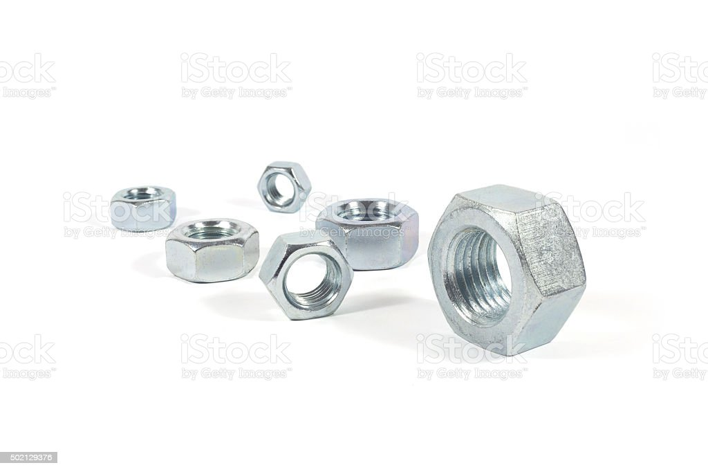 Metal Nuts Of Different Sizes Isolated On White stock photo