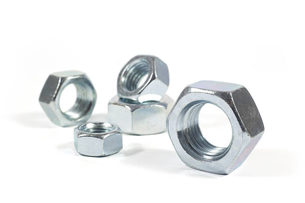Metal Nuts Of Different Sizes Isolated On White Metal Nuts Of Different Sizes Isolated On White Background bolt fastener stock pictures, royalty-free photos & images