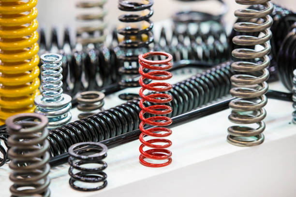 metal of different sizes car springs Multicolored metal of different sizes car springs amortize stock pictures, royalty-free photos & images