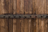 istock Metal on old wooden background for design 521528184