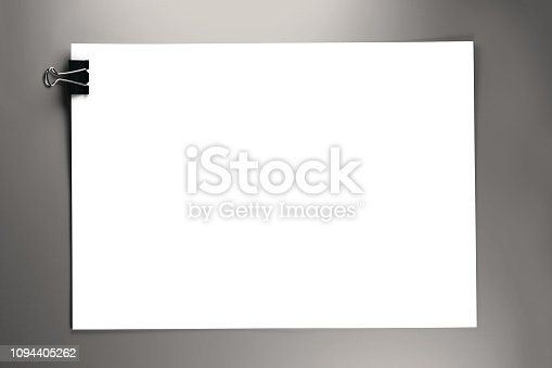 istock Metal Paper Clip on Blank White Paper 1094405262