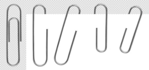 Metal paper clips isolated and attached to paper stock photo