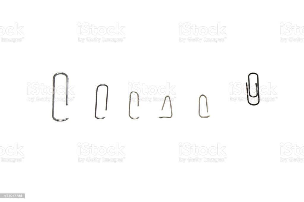 Metal paper clips, isolated royalty-free stock photo