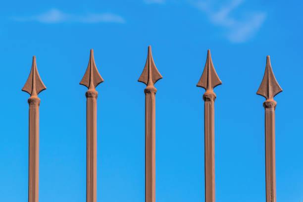 Metal peaks against the blue sky stock photo