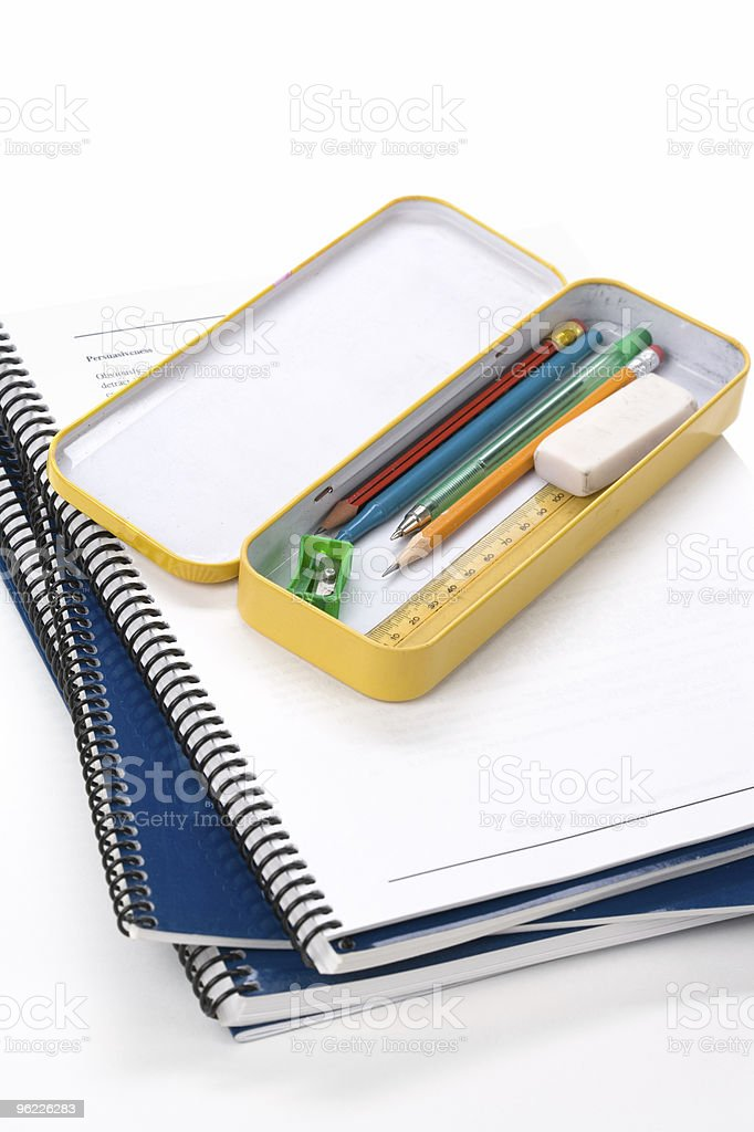 metal pencil case and book royalty-free stock photo