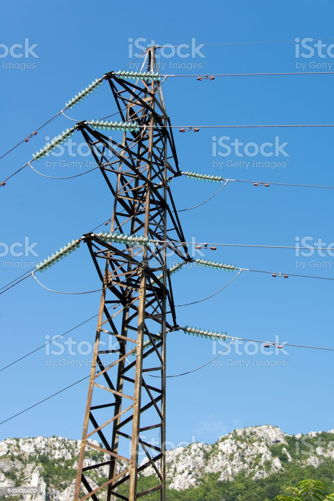 Metal pillar High Voltage against the blue sky. stock photo