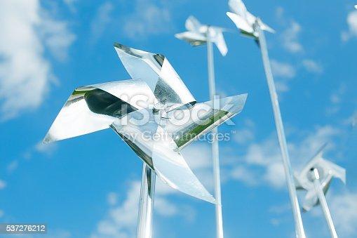 istock metal pinwheels on background blue sky 537276212