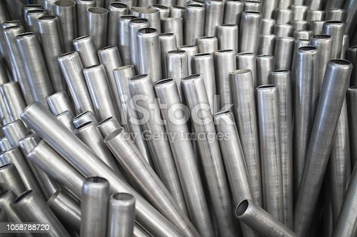 511814244istockphoto Metal Pipe Abstract 1058788720