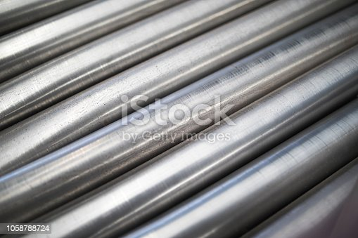 511814244istockphoto Metal Pipe Abstract 1058788724